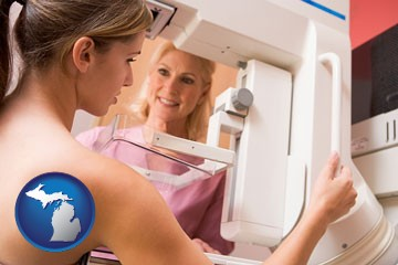 a nurse assisting a patient with a mammogram test - with Michigan icon
